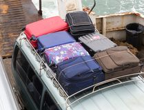 Suitcases on the car Stock Images