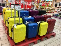 Suitcases in Chinese supermarket for sales. Various suitcase with price tag indoor selling Royalty Free Stock Image