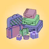 Suitcases  on a colored background. Royalty Free Stock Photo