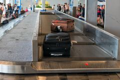 Suitcases on the conveyor belt. At the airport Stock Image