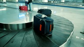 Suitcases on conveyor belt of airport. Tunisia. Djerba Island stock video footage