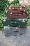 Suitcases. Four old suitcase lying on each other reminiscent of the tower Stock Photo
