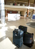Suitcases in hotel lobby. Three suitcases waiting in a modern hotel lobby Stock Photos