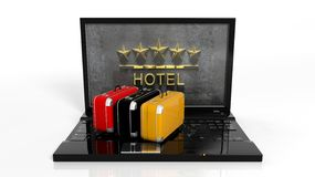 Suitcases on laptop keyboard with 5 stars Royalty Free Stock Images