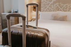 Suitcases in light hotel room stock images