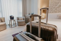 Suitcases in light hotel room royalty free stock photo