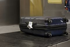 Suitcases on a luggage band on the airport. Horizontal view Royalty Free Stock Photography