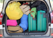 Suitcases and luggage in the car. Car and plenty of luggage and suitcases when leaving for family summer holidays Stock Photography