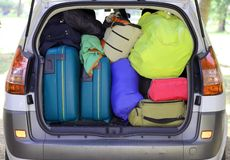 Suitcases and luggage in the car. Car and plenty of luggage and suitcases when leaving for family summer holidays Royalty Free Stock Photo