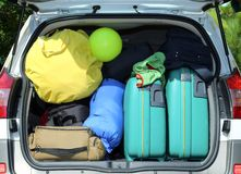 Suitcases and luggage in the car. Car and plenty of luggage and suitcases when leaving for family summer holidays Royalty Free Stock Images