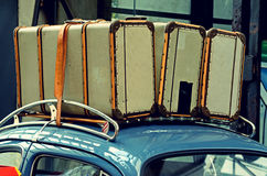 Suitcases on a luggage carrier on the roof of the old car. Vinta Royalty Free Stock Photography