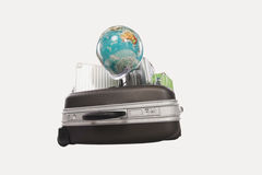 Suitcases and luggages with globe against white background Royalty Free Stock Photos