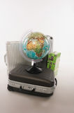 Suitcases and luggages with globe against white background Royalty Free Stock Photography