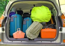 Suitcases and many bags in the car. Twosuitcases and many bags in the trunk of the car ready to depart Royalty Free Stock Photo