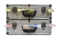 Suitcases with money. Suitcases with dollar and euro banknotes on white background stock photo