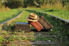 Suitcases old  on railway tracks. Suitcases old stand on railway tracks Royalty Free Stock Photography
