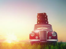 Suitcases are on roof of car. Toward adventure! The suitcases are on the roof of a vintage car Royalty Free Stock Images