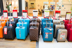 Suitcases for sale. POZNAN, POLAND - MARCH 21, 2014: Rows of suitcases for sale at the Galeria Malta shopping mall Royalty Free Stock Photos