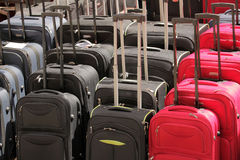 Suitcases for sale. Row of cheap suitcases for sale on a Brixton market Royalty Free Stock Photo