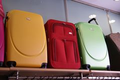 Suitcases on a shelf. Display of suitcases on a shelf in a store for sale Stock Photo