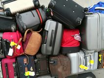 Suitcases stacked on the cart. Suitcases stored at the airport Royalty Free Stock Image