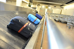 Suitcases on a transportation belt at the airport Stock Photo