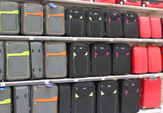 Suitcases. For travel placed on shelves in supermarket Stock Images