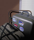 Suitcases with travel stickers on handc Stock Photo