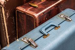 Suitcases. 3 vintage suitcases seen in London`s Brick Lane Market Royalty Free Stock Photo