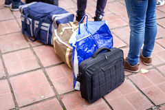 Suitcases of waiting travelers Stock Photo