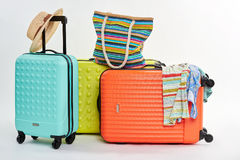 Suitcases and woman beach accessories. Royalty Free Stock Image
