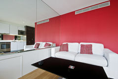 Suite apartman in red. With reflection of kitchen in the mirror Royalty Free Stock Photos