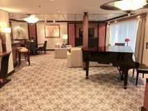 Suite onboard cruise ship. The Royal Suite, the most luxurious stateroom onboard Royal Caribbean International cruise ship Mariner of the Seas stock image