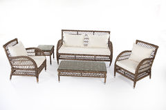Suite Of Wicker Furniture. Made of synthetic fibre on isolated background Royalty Free Stock Image