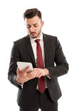 Suited business man using a tablet Stock Image