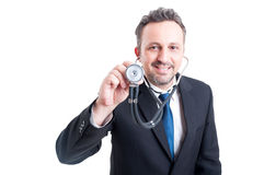 Suited male doctor with stethoscope Royalty Free Stock Photo