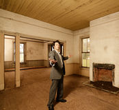 Suited man in Abandoned Home Royalty Free Stock Images