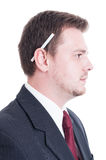 Suited man holding a cigarette behind ear Stock Image