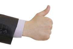 A suited man holding thumbs up on white background. A suited man holding thumbs up sign isolated on white background Stock Photography