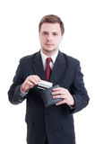 Suited man pulling credit card from wallet Royalty Free Stock Images