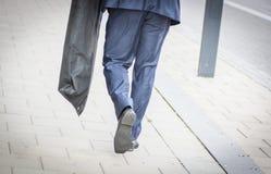 Suited man walking Stock Photos