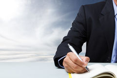 Suited man writing dairy Royalty Free Stock Photos