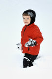 Suited for Snow. A bundled up two-year-old boy treads through heavy snow Royalty Free Stock Image