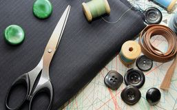 Suiting fabric, scissors, buttons and Pattern Stock Image