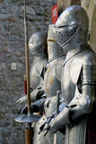 Suits of armour. Three suits of armour in front of a museum in Mont Saint-Michel (Normandy) in France Royalty Free Stock Photography