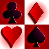 Suits of cards. 4 suits of cards on the red and white background Stock Image