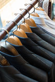 Suits on hangers Royalty Free Stock Images
