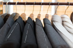 Suits on hangers Stock Photo
