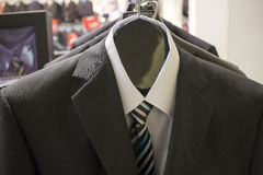Suits and shirts on a rack Royalty Free Stock Photos