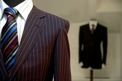 Suits on Shop Mannequins. Modern and professional looking suits on mannequins with focus on foreground Stock Photography